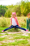 Little girl in jeans and a shirt near a river  with apples Royalty Free Stock Images