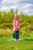 Little girl in jeans and a shirt Royalty Free Stock Image