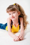 Little girl in jeans on a white background Stock Photography