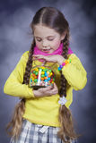 Little girl with jelly bean. Stock Images