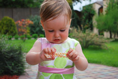 Little girl with jewellery. Little girl play with jewellery on nature Stock Photos