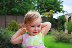 Little girl with jewellery. Little girl play with jewelleryand smile on nature Stock Photography