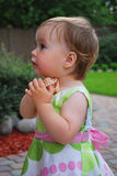 Little girl with jewellery. Little girl play with jewellery on nature stock images