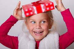 Child put a box on his head Stock Images