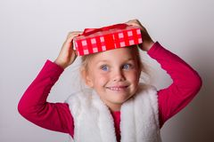Child put a box on his head Royalty Free Stock Photo