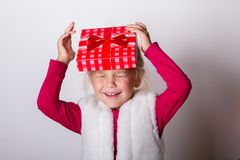 Child put a box on his head Stock Photos