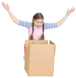 Little girl joyfully looks in a box Stock Photos