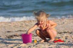 Little girl joys on a beach stock photography