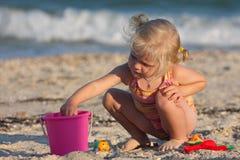 Little girl joys on a beach Royalty Free Stock Image