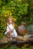 Little girl with a jug Royalty Free Stock Photos