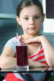 Little girl with juice Stock Photography
