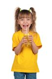 Little girl with juice Stock Images