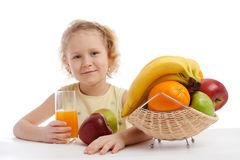 Little girl with juice and fruit Royalty Free Stock Photo
