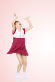 Little girl  jump with her hands up. Stock Images