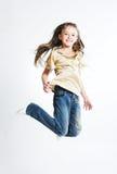 Little girl jump over white background Stock Image