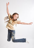 Little girl jump over white background Royalty Free Stock Images