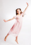 Little girl jump over white background Royalty Free Stock Photos