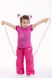 Little girl with jump rope on white Stock Image