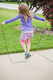 Little girl jump roping Royalty Free Stock Photography