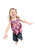 Little girl jumping. For joy isolated on a white background Stock Image