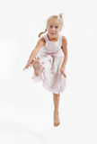 Little girl jumping. And staring into the camera Stock Photo