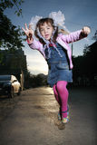 Little girl jumping. On a street Royalty Free Stock Images