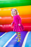 Little Girl Jumping And Bouncing Stock Photo