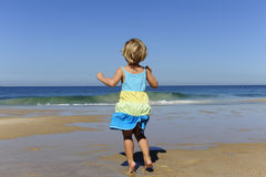 Little girl jumping on the beach Stock Photography