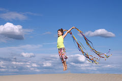 Little girl jumping on the beach Royalty Free Stock Photography