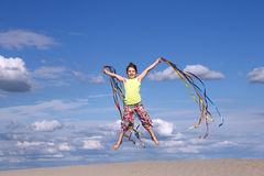 Little girl jumping on beach Royalty Free Stock Images