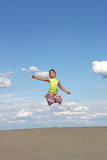 Little girl jumping on beach Stock Photography