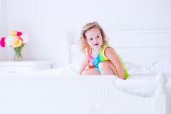 Little girl jumping on a bed Stock Photo