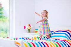 Little girl jumping on a bed Royalty Free Stock Images