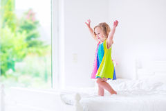 Little girl jumping on a bed Royalty Free Stock Photos