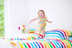 Little girl jumping on a bed Royalty Free Stock Image