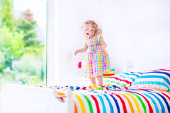 Little girl jumping on a bed Stock Photography