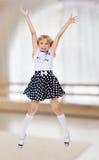 Little girl jumping Stock Images