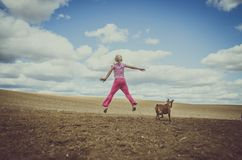 Active child and dog royalty free stock images