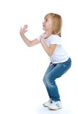 Little girl jumping hands up Royalty Free Stock Photography