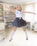 Little girl jumping Stock Photos