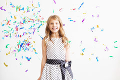 Little girl jumping and having fun celebrating birthday Stock Images