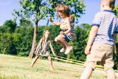 Little girl jumping high through the elastic. stock image