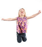 Little girl jumping for joy. A young girl jumping for joy isolated on white Royalty Free Stock Photos