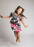 Little girl jumping of joy Stock Image