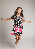 Little girl jumping of joy Stock Photo