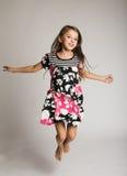 Little girl jumping of joy. Little smiling girl jumping of joy Stock Photo