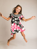 Little girl jumping of joy. Little smiling girl jumping of joy Stock Photos