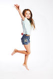 Little girl jumping of joy royalty free stock image