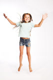 Little girl jumping of joy Royalty Free Stock Image