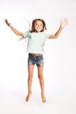 Little girl jumping of joy. Little smiling girl jumping of joy on white background Royalty Free Stock Image